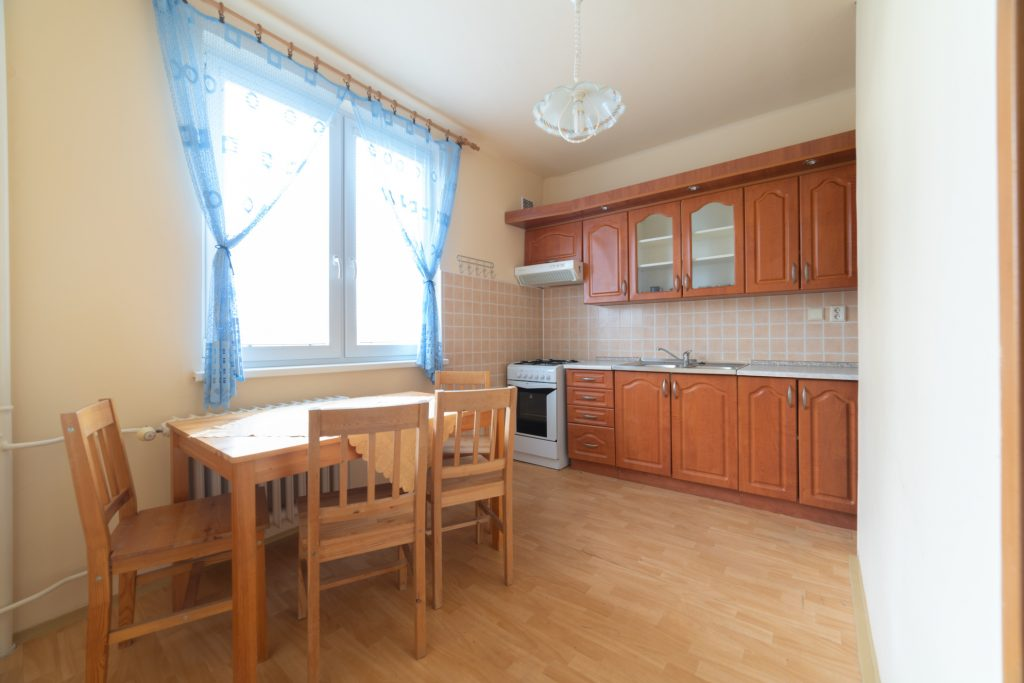 Live few steps from the city center in spacious apartment. Enjoy your coffee on the balcony. Have green surroundings with playground for kids, primary school, fitness center and pub around the flat house.